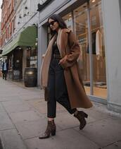 coat,brown coat,brown boots,scarf,belt,black pants,black blouse,black sunglasses
