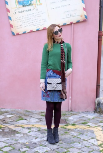 fashion and cookies blogger sunglasses scarf sweater skirt bag shoes green sweater gucci bag gucci denim skirt ankle boots boots fall outfits