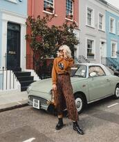 skirt,pleated skirt,zebra print,midi skirt,flat boots,handbag,sweater,sunglasses