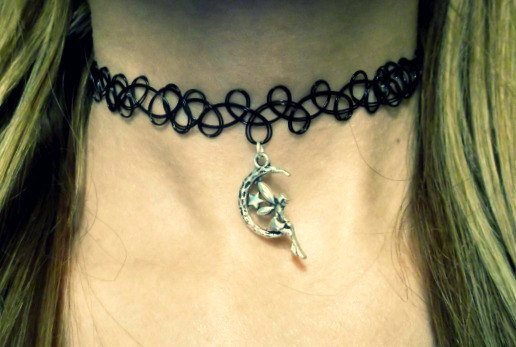 Silver fairy on a crescent moon choker necklace