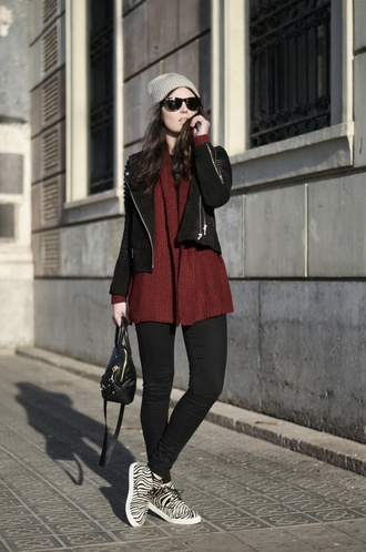 views by laura blogger sunglasses burgundy sweater zebra print black jeans leather jacket beanie