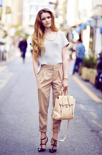 t-shirt valentino rockstud valentino camel pants grey t-shirt camel bag phillip lim handbag kayture kristina bazan blogger top blogger lifestyle heels high heels black high heels studded sandals sandal heels slingbacks spring outfits pants shoes bag jewels