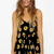 Black Sunflower Print Romper @ Rompers And Jumpsuits For Women-Strapless Jumpsuit,Long Sleeve Jumpsuit,Long Sleeve Romper,Short Rompers,Floral Romper,Strapless Romper,Floral Jumpsuit,Backless Jumpsuit,Black Jumpsuit,Denim Jumpsuit,V Neck Jumpsuit