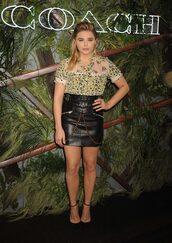 skirt,leather,leather skirt,chloe grace moretz,pumps,blouse,top,shirt,summer outfits,mini skirt