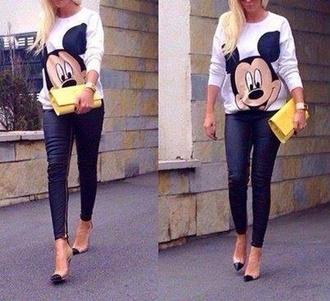 sweater disney leather pants mickey mouse zipped pants white sweater oversized sweater oversized white sweater blonde hair yellow yellow clutch slim pants sunglasses heels pumps black jelena karleusa