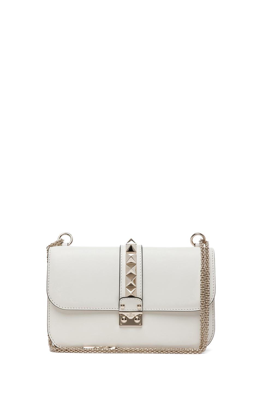 Medium lock flap bag in light ivory
