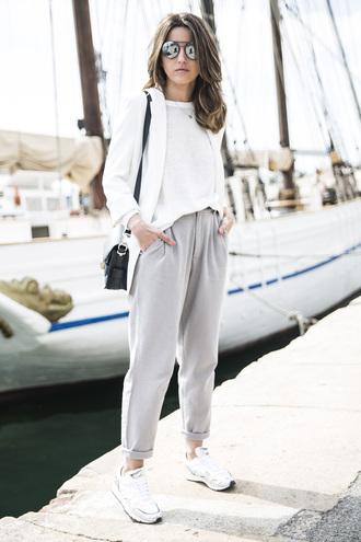 shoes sunglasses white shirt white blazer grey pants white sneakers black handbag blogger