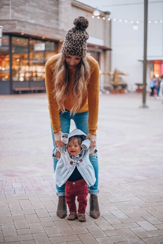 thegirlintheyellow dress blogger sweater jeans shoes bag hat coat pants beanie orange sweater ankle boots mother and child