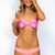 Lolli Swim Bow bandeau/halter top in tropic pink