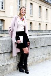 bag,clutch,metallic clutch,skirt,black skirt,boots,black boots,top,white top,trench coat,pink coat,skater skirt,necklace,statement necklace,silver clutch