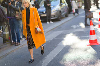 coat fashion week street style fashion week 2016 fashion week paris fashion week 2016 mustard skirt animal print midi skirt printed skirt top black top shoes loafers black shoes flats streetstyle bag masculine coat