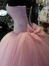 dress,prom dress,pink sparkly prom dress,pink dress,princess dress,ball gown dress,corset,bow,clothes,pink,beautiful,studded,dream dress,need so bad,prom,2015 prom,glitter,long prom dress,light pink,rose,blush,baby pink,coloured,sparkle,poofy,lace up,diamonds,lace dress,bows,pink sparkly dress,sparkly dress,idk,idk i'm new to this so the ones on the picture.,pink prom dress,princess,pink poofy and sparkly,quinceanera dress,pastel pink,Bow Back Dress,tulle dress,rhinestones,sweet 16 dresses,pink quinceañera dress,beaded dress,peach dress,bow dress