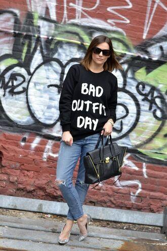 bag phillip lim silver pumps pashli phillip lim satchel black sweater slogan t-shirts blue jeans ripped jeans black sunglasses streetstyle black tote