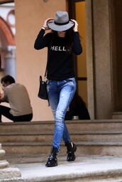 sweater,hat,kendall jenner,streetstyle,fashion week 2014,felt hat,black t-shirt,cropped pants,ankle boots,shoes,boots