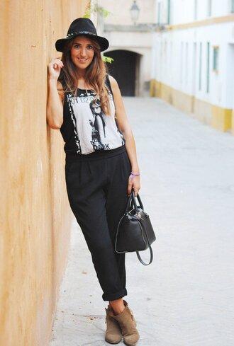 pants black graphic t-shirt black hat black trousers brown boots blogger