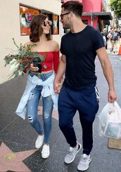top,off the shoulder,red,olivia culpo,jeans,sneakers,sunglasses