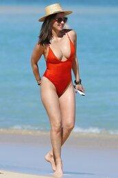swimwear,red,one piece swimsuit,plunge v neck,olivia munn,beach,summer holidays,hat,straw hat