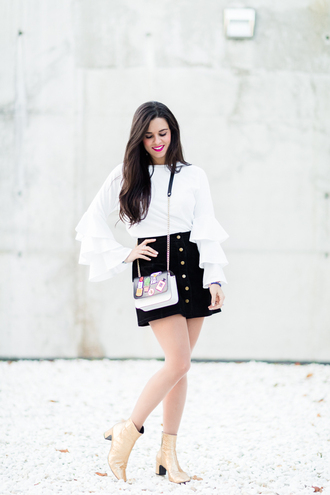 crimenes de la moda blogger coat sunglasses jewels shoes blouse tumblr white blouse white top ruffle ruffled top bell sleeves skirt mini skirt black skirt button up button up skirt boots gold boots ankle boots mid heel boots bag printed bag