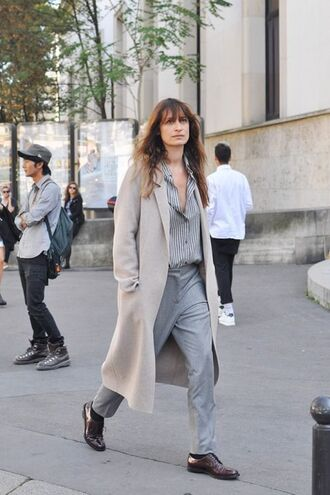 coat model caroline de maigret fashionista trench coat nude coat pants grey pants shirt striped shirt grey shirt office outfits shoes brown shoes streetstyle