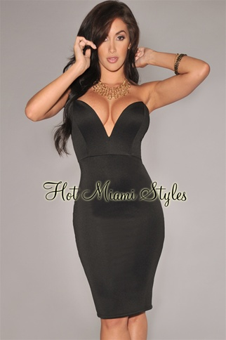 Black low plunge strapless knee length dress
