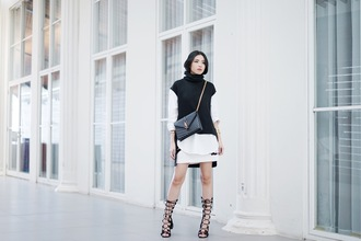 olivia lazuardy blogger white skirt lace up heels yves saint laurent black sweater sleeveless white top sleeveless turtleneck sweater