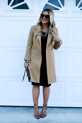 all dolled up blogger camel coat classy