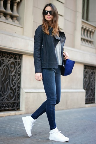 shoes black jacket white shirt blue and black bag jeans sunglasses white sneakers blogger
