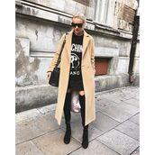 coat,tumblr,beige coat,long coat,t-shirt,black t-shirt,quote on it,mini skirt,black skirt,over the knee boots,black boots,bag,black bag,flat boots,sunglasses,black sunglasses