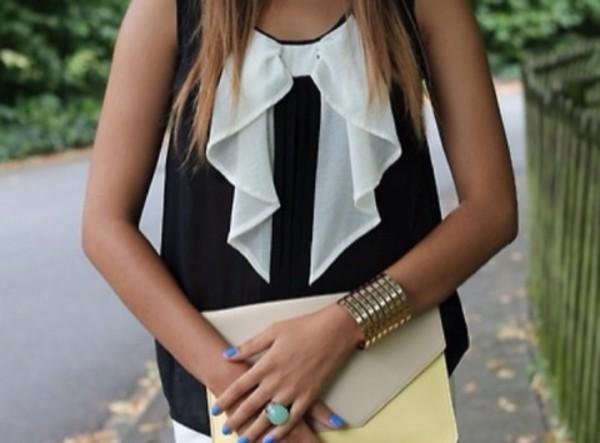 blouse bow contrasting black white bag nail polish jewels