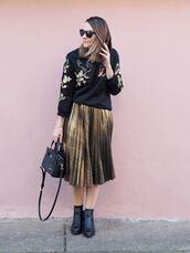 skirt,black floral sweater,gold pleated skirt,black purse,black booties,sunglasses