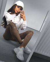 sweater,cool,fashion,fashionista,modern,style,pretty,beautiful,girly,girl,white,hat,baseball cap,iphone,iphone cover,make-up,brunette,white sweater,cut-out,pants,jeans,olive green jeans,nike,nike shoes,white sneakers,cute