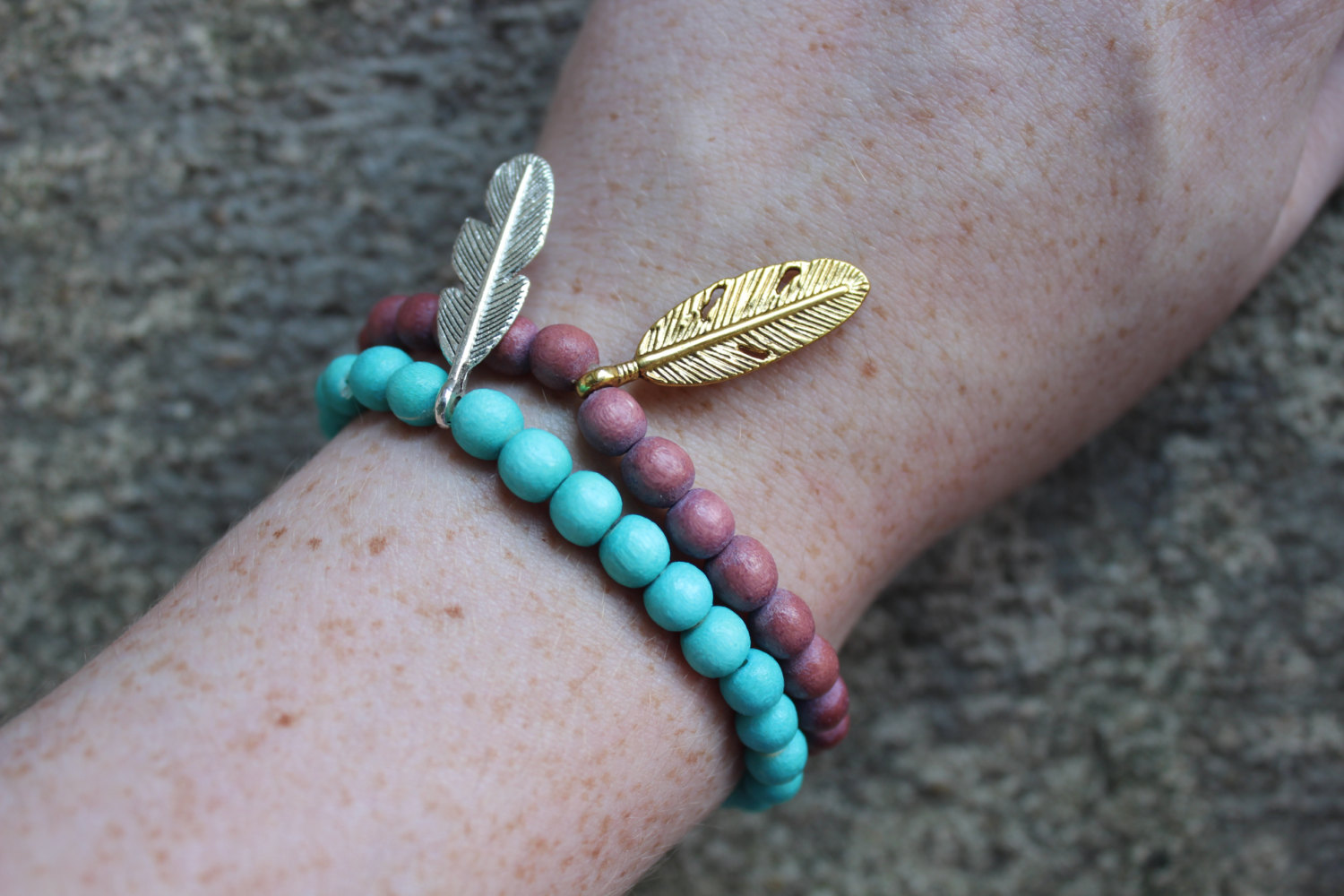 Wooden beaded bracelet with feather charm