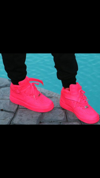 shoes air forces hot pink neon pink nike air force  1s. nike air nike air force 1 high top nike shoes nike high tops socks pink nike dope nicki minaj style nice luxury beautiful nike air force custom sneakers nike air force 1 womens air force 1s all neon pink nike hightops i prefer sneakers over boots but i can do both because im not basic get like me smooches $$$$