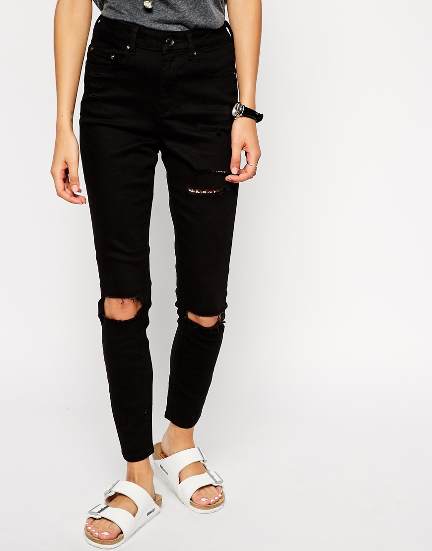 ASOS Ridley High Waist Skinny Ankle Grazer Jeans in Clean Black with Thigh Rips and Busted Knees at asos.com