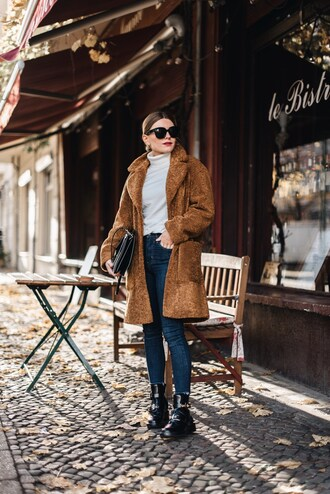 coat tumblr winter outfits teddy bear coat brown coat denim jeans blue jeans top white top turtleneck boots black boots sunglasses