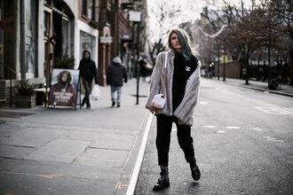fashionmews blogger jumpsuit top shoes coat bag fur coat shoulder bag boots winter outfits black sweater