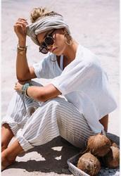 pants,white,tan,striped pants,harem pants,white t-shirt,sabo skirt,cotton,style,model,beach style,chilled,bohemian,sunglasses,turban wrap,shirt