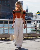 pants,stockholm fashion week,streetstyle,sweater,white pants,wide-leg pants,high waisted pants,bag