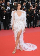 shoes,gown,prom dress,red carpet dress,feathers,white,white dress,sandals,slit dress,dress,sexy dress,plunge dress