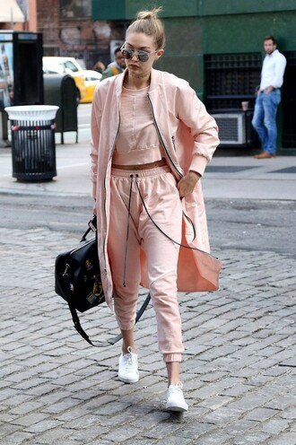 jacket sweatshirt sweatpants sneakers gigi hadid spring outfits sunglasses nude pink top pink coat black bag white sneakers aviator sunglasses gigi hadid style rose white shoes pink bomber jacket bomber jacket long bomber jacket top sweater