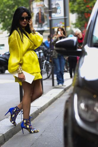 dress puffed sleeves yellow dress mini dress short dress long sleeves long sleeve dress streetstyle bracelets cuff bracelet sandals sandal heels high heel sandals blue sandals lace up sandals sunglasses puff sleeve dress
