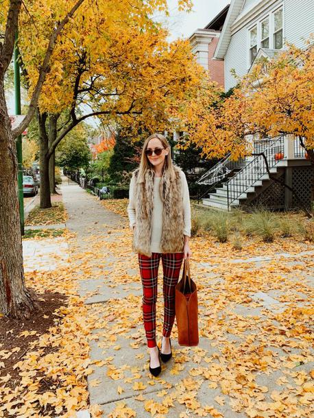 kelly in the city - a preppy chicago life style and fashion blog blogger jacket leggings dress pants faux fur vest vest tote bag fall outfits red pants plaid pants
