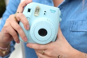 home accessory,baby blue,instant,polaroid camera