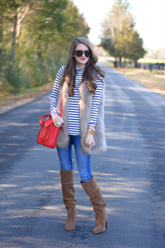 southern curls and pearls blogger jewels jeans bag boots grey fur vest sunglasses tortoise shell sunglasses red bag turtleneck striped turtleneck stripes striped top denim blue jeans brown boots