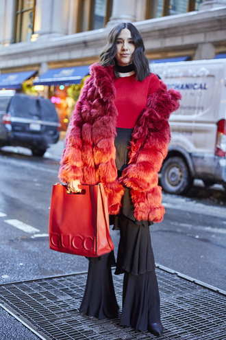 coat nyfw 2017 fashion week 2017 fashion week streetstyle flare pants ruffle ruffle pants high waisted pants top red top fur coat faux fur coat big fur coat red coat bag red bag gucci gucci bag choker necklace black choker 00s style