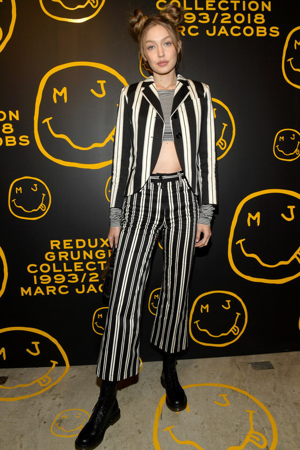 top black and white crop tops blazer stripes striped top striped pants gigi hadid model off-duty