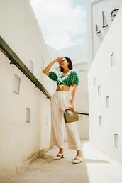 olivia lazuardy,blogger,top,pants,bag,shoes,green top,pumps,white pants,fall outfits