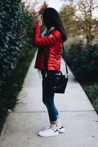 jacket red puffer jacket skinny jeans white sneakers black bag blogger