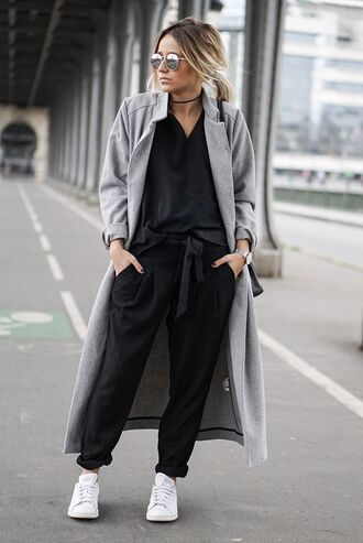 pants black shirt sunglasses grey coat black pleated pants white sneakers blogger
