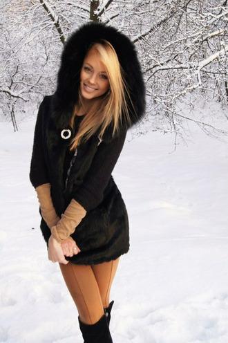 black coat blond hair